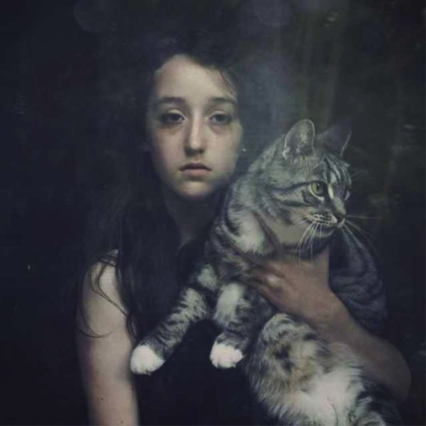 """Eleanor Hardwick, """"Untitled (self-portrait behind glass with cat),"""" 2009"""