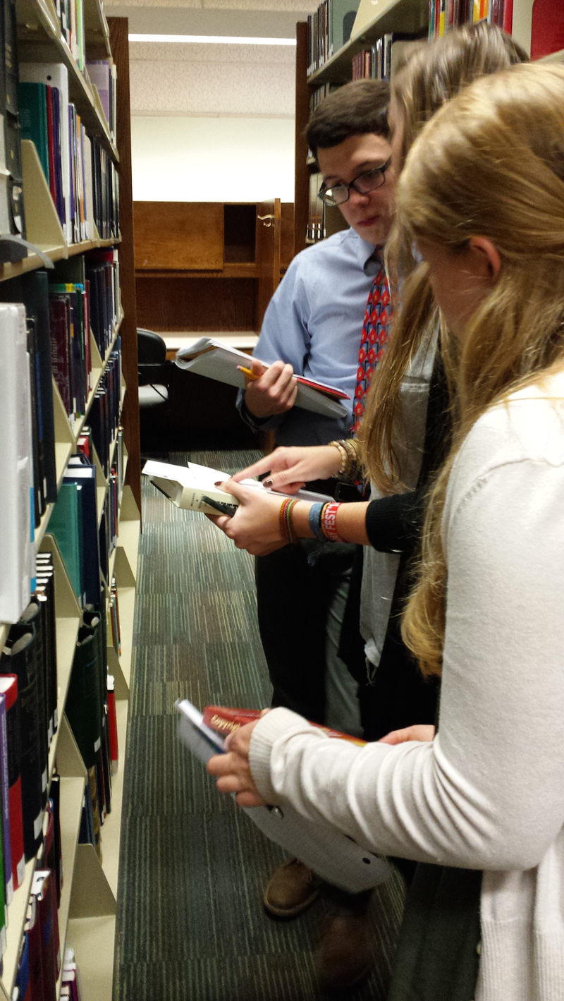 Students looking up books in the law library. Meghan Rosatelli